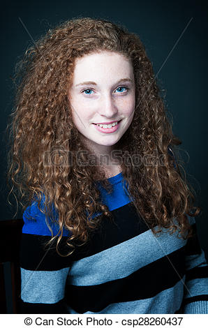 Pretty curly haired teen. Beautiful teenage girl with amazing .