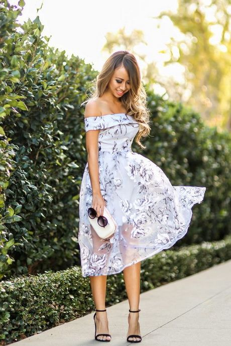 Picture Of delicate lilac colored floral off the shoulder dress .