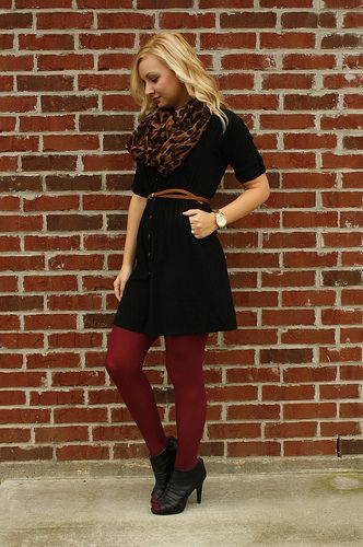 Love the red tights with the black dress, the brown belt and scarf .